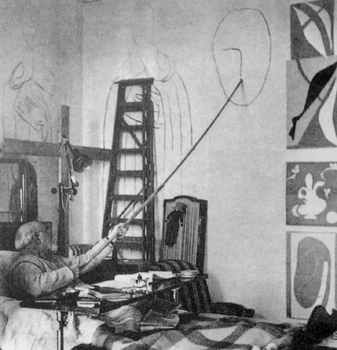 Matisse draws a head for the Chapelle du Rosaire in his studio Hotel Regina, Cimiez, 1950