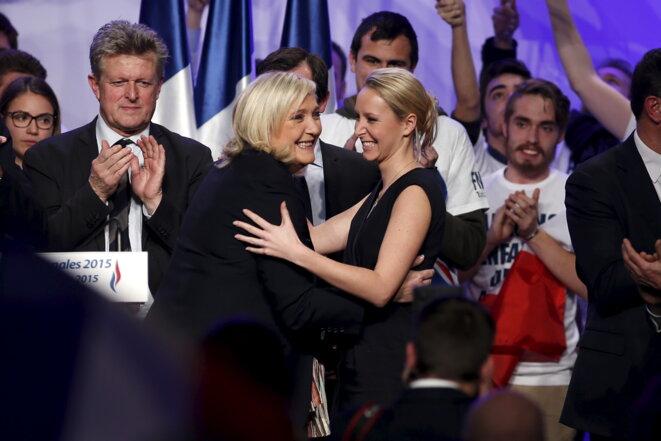 Marine Le Pen et Marion Maréchal-Le Pen, en meeting à Paris, le 17 décembre. © Reuters