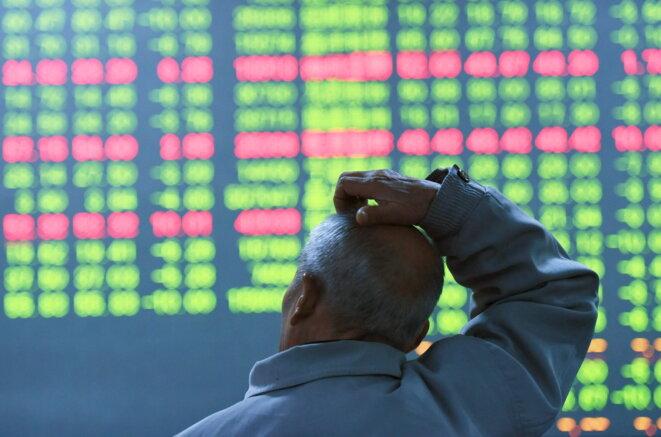 En Chine, les indicateurs en vert indiquent une baisse, en rouge, une hausse © Reuters