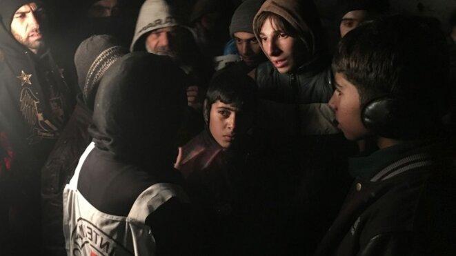 A l'arrivée d'un convoi humanitaire à Madaya, la ville plongée dans les ténèbres. © CICR