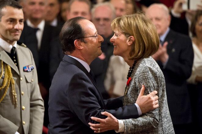 Anne Lauvergeon lors de la remise de sa Légion d'honneur par François Hollande en 2014. © Reuters