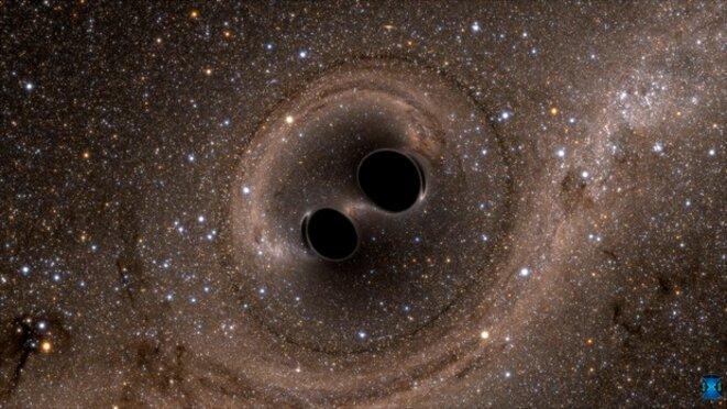 Image de simulation de la fusion de deux trous noirs. © the Simulating eXtreme Spacetimes (SXS) project