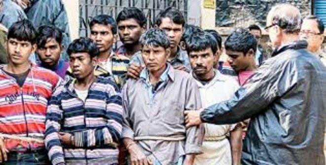 Les treize hommes arrêtés tels qu'ils apparaissent dans la presse © DR