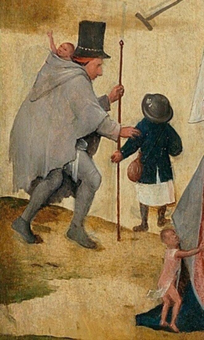 L'homme au chapeau, avec un enfant dans sa hotte, détail du Chariot de foin : diverses interprétations, dont celle d'un voleur d'enfants