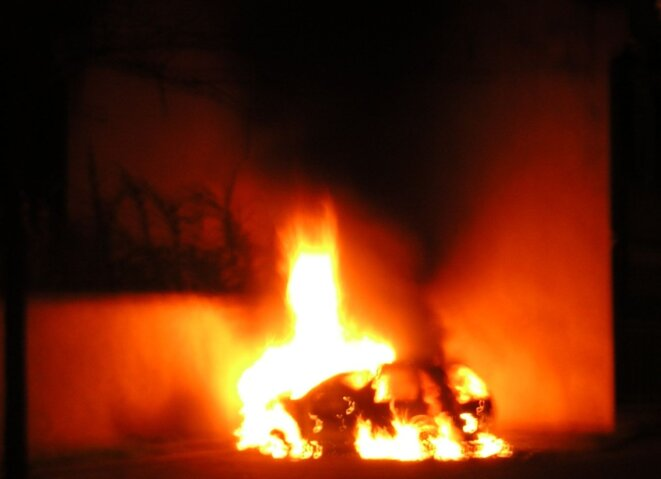 A torched car during riots in Strasbourg in 2005.
