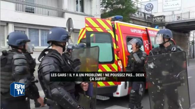 Les gendarmes autour du camion de pompiers où est allité Romain Dussaux (26 mai 2016, Paris) © Capture d'écran d'images de BFMTV