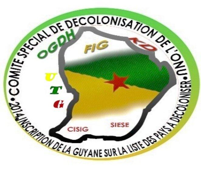 """Autocollant de campagne, 2014, d'inscription de la Guyane au """"Comité des 24 de l'ONU"""", Politiques Spéciales et Dėcolonisation. (Union des Travailleurs Guyanais, le 26 juillet 2016)."""