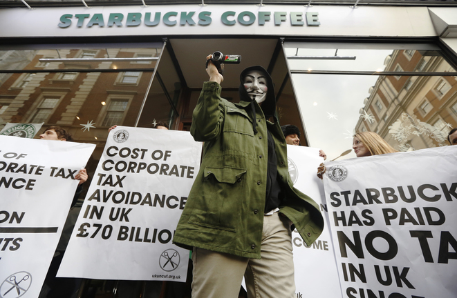 Manifestation contre Starbucks en 2014 à Londres © Reuters