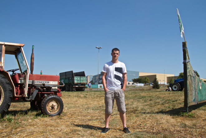 One of the protesters, Adrien, in front of the headquarters of dairy group Lactalis. © Laurent Geslin