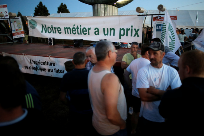 Farmers protesting outside the headquarters of dairy firm Lactalis, at Laval, central-west France, August 23rd. ©Reuters