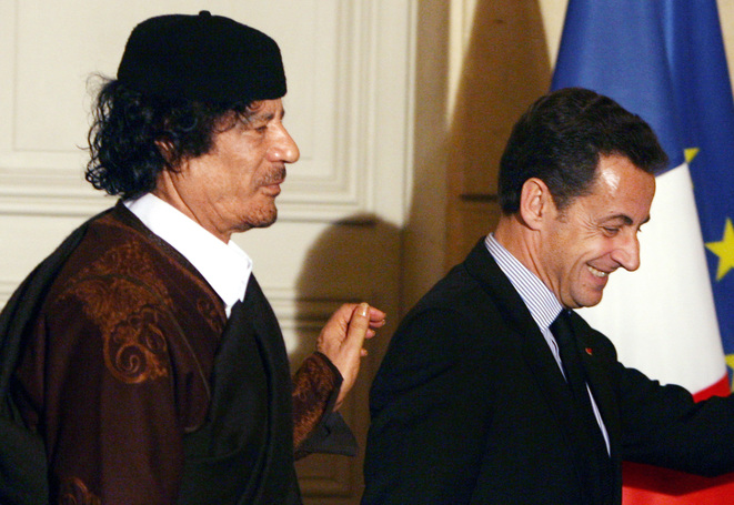 Muammar Gaddafi and Nicolas Sarkozy in Paris in December 2007. © Reuters
