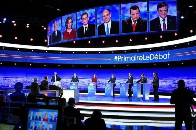 Les sept candidats sur le plateau de TF1, jeudi 13 octobre. © Reuters