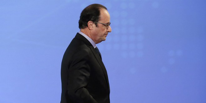 François Hollande: leaving by the back door? © Reuters