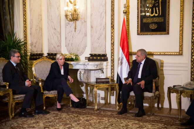 Marine Le Pen meeting in Cairo with then-Egyptian prime minister Ibrahim Mahlab, in May 2015.