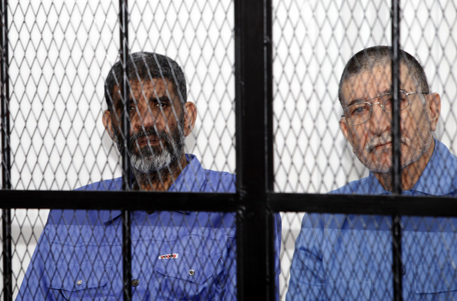 Mohamed Abdulla Senussi (left) during his trial in Tripoli in April 2014. © Reuters
