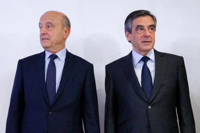 Alain Juppé et François Fillon au siège de la Haute autorité de la primaire, le 27 novembre au soir. © Reuters