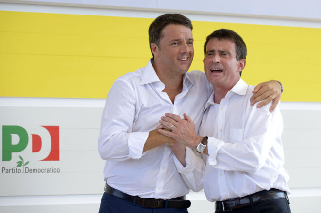 Matteo Renzi (l) and Manuel Valls in September 2014.
