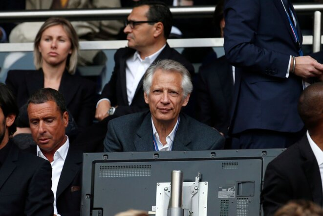 Alexandre Djouhri, centre left, and former premier Dominique de Villepin, centre, at the Parc des Princes football stadium, April 23rd, 2014. © Benoit Tessier Reuters