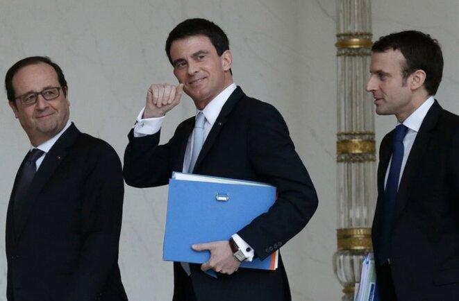 François Hollande, Manuel Valls et Emmanuel Macron. © Reuters