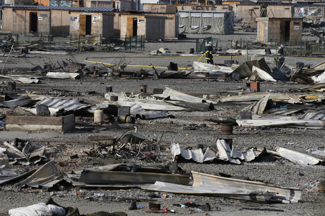 Razed to the ground: the camp at Grande-Synthe following the April 10th overnight blaze. © Reuters