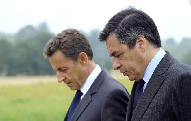 Nicolas Sarkozy y François Fillon, en 2012. © Reuters