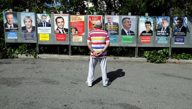 Campaign posters of the 11 candidates in southern France. © Reuters