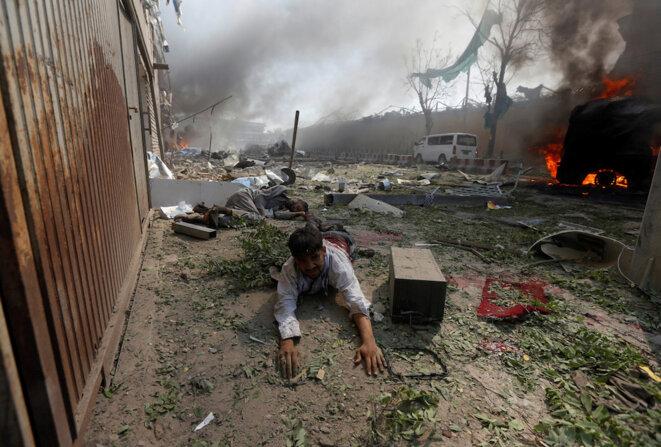 Un blessé juste après l'explosion © Reuters