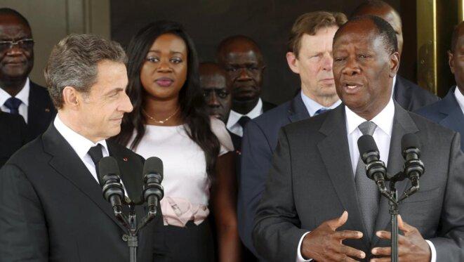 Sarkozy et Ouattara, une vieille amitié. L'ex-chef de l'État français s'est rendu à Abidjan en mars 2016. © Reuters