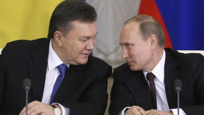 Viktor Ianoukovitch, qui vit désormais à Moscou, et Vladimir Poutine © Reuters