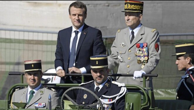 President Emmanuel Macron and General Pierre de Villiers (standing) during this year's Bastille Day parade. © Reuters
