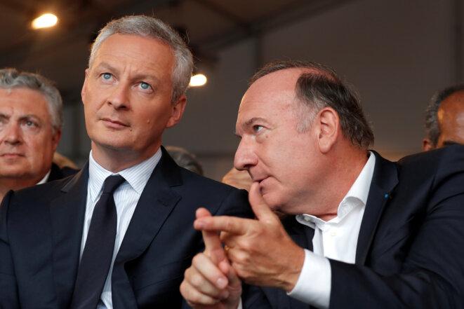 Bruno Le Maire, ministre de l'économie et des finances, avec Pierre Gattaz, président du Medef, lors de l'université d'été du syndicat patronal, le 30 août 2017. © Reuters