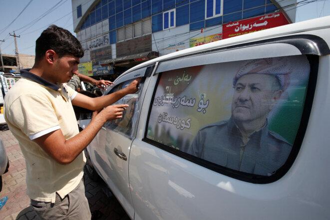 Une affiche avec le portrait de Massoud Barzani appelant à voter en faveur du référendum le 25 septembre 2017. © Reuters