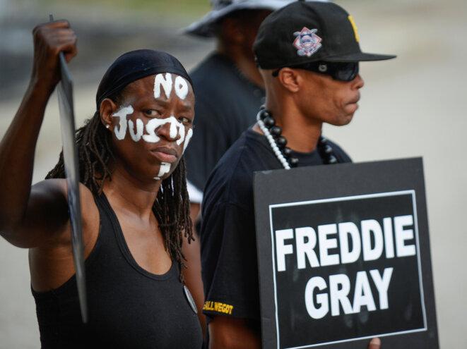 Manifestation devant l'hôtel de ville de Baltimore, le 27 juillet 2016. © Reuters