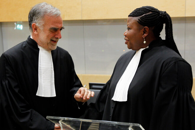 Luis Moreno Ocampo and his successor Fatou Bensouda at the International Criminal Court in The Hague, June 2012. © Reuters