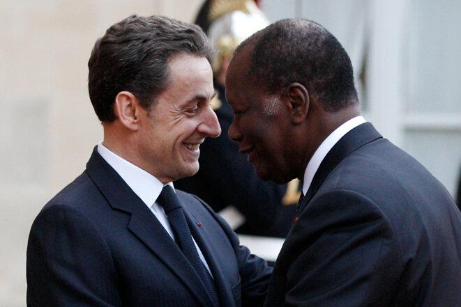 Nicolas Sarkozy et Alassane Ouattara, le 22 juin 2012, à l'Élysée. © Gonzalo Fuentes/Reuters