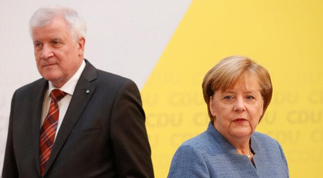 Le Bavarois Horst Seehofer, lors d'une conférence de presse à Berlin le 9 octobre 2017 avec Angela Merkel © Reuters / Hannibal Hanschke.