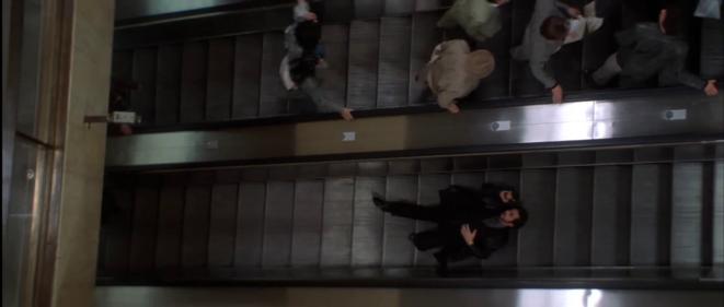 Al Pacino dans l'escalator de « L'Impasse » (1993) de Brian De Palma.