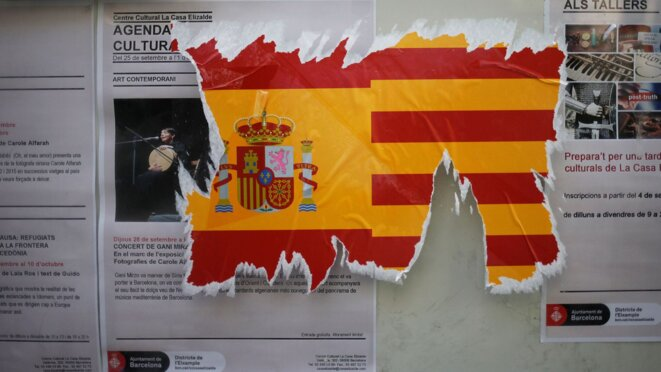 a-damaged-sticker-of-the-spanish-flag-is-seen-on-a-wall-ahead-of-the-banned-october-1-independence-referendum-in-barcelona-5953268