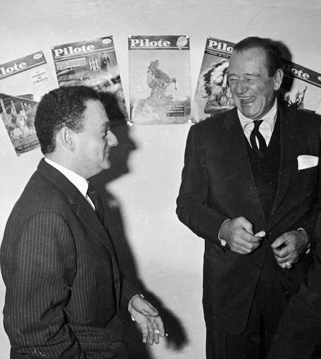 René Goscinny et John Wayne dans les bureaux de Pilote, publiée dans Pilote n° 58, 1er décembre 1960 Crédit : Fonds d'archives Institut René Goscinny © Droits réservés