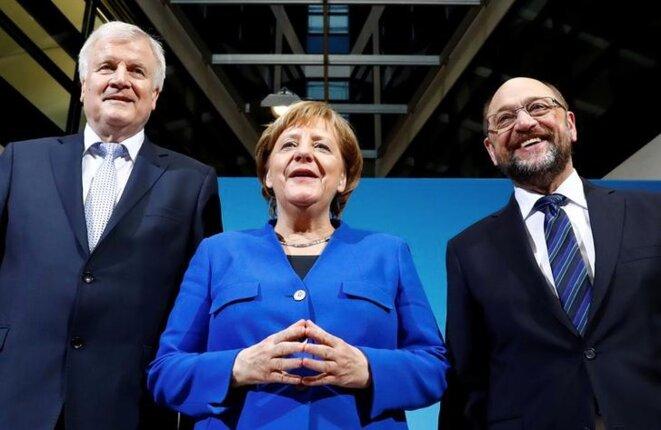 Angela Merkel, avec le responsable de la CDU en Bavière Horst Seehofer et le responsable du SPD Martin Schulz, à Berlin, le 12 janvier 2018. © Reuters