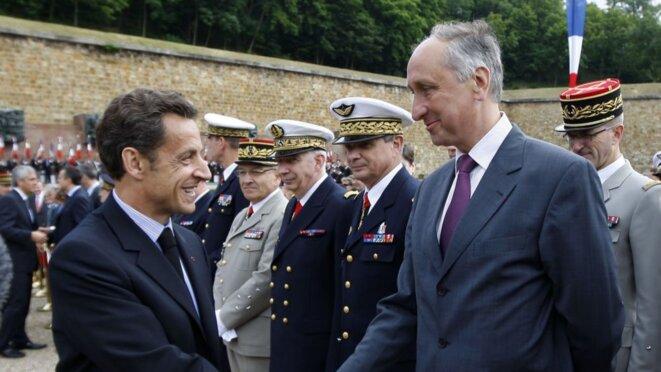 Nicolas Sarkozy et Philippe Courroye en juin 2009 © Reuters