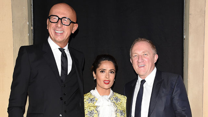 Gucci bos Marco Bizzarri (left), actress Salma Hayek and her husband François-Henri Pinault in Milan in 2016. © Kering