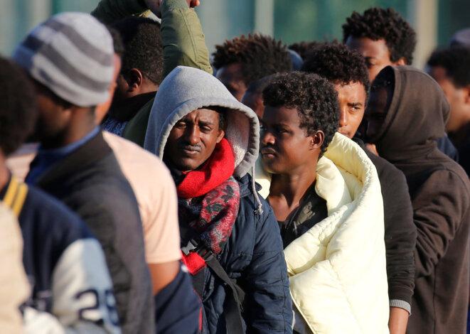 Des migrants d'Érythrée et d'Éthiopie, le 23 août 2017. © Reuters / Pascal Rossignol.