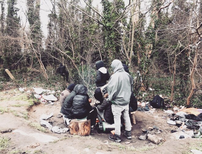 A group of migrants living rough in Calais, February 2018. © Elisa Perrigueur.