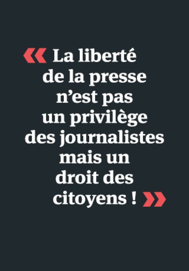 The poster reads: 'Freedom of the press isn't a privilege for journalists but a right for citizens!'