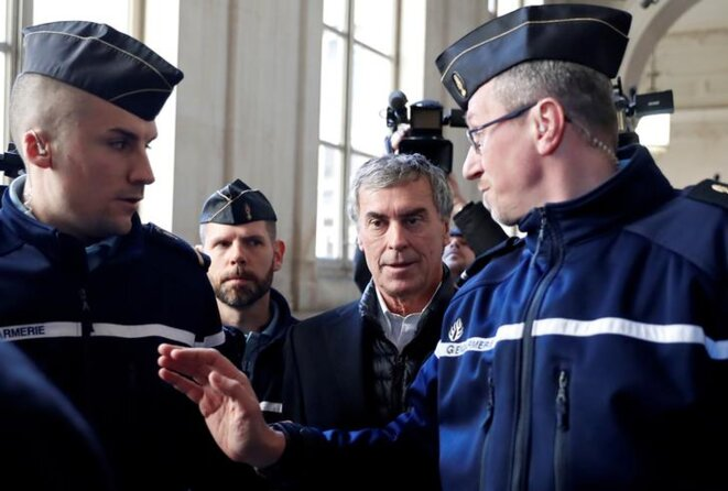 Jérôme Cahuzac (centre) arriving in court on February 12th. © Reuters