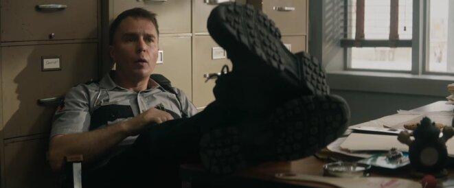 Dixon (Sam Rockwell)