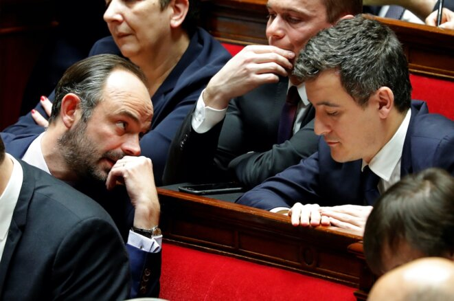 Gérald Darmanin, seen here on the right, talking with prime minister Édouard Philippe at the National Assembly on January 30th, 2018. © Reuters