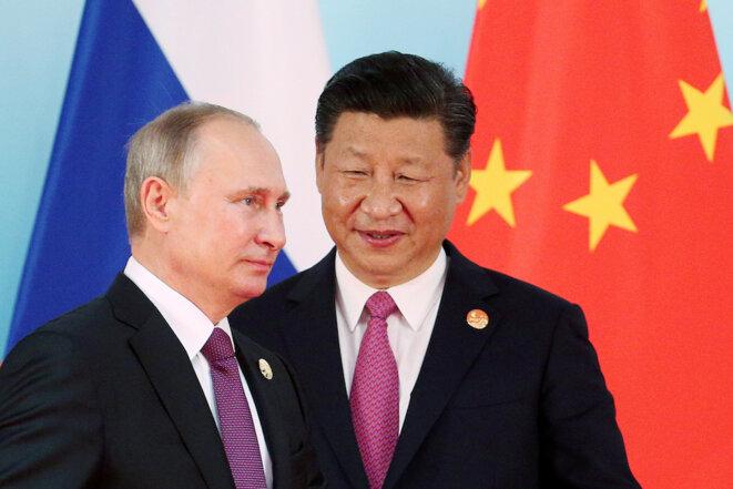 """Vladimir Poutine et Xi Jinping, deux présidents """"providentiels"""" qui jouent la même partition © Reuters"""