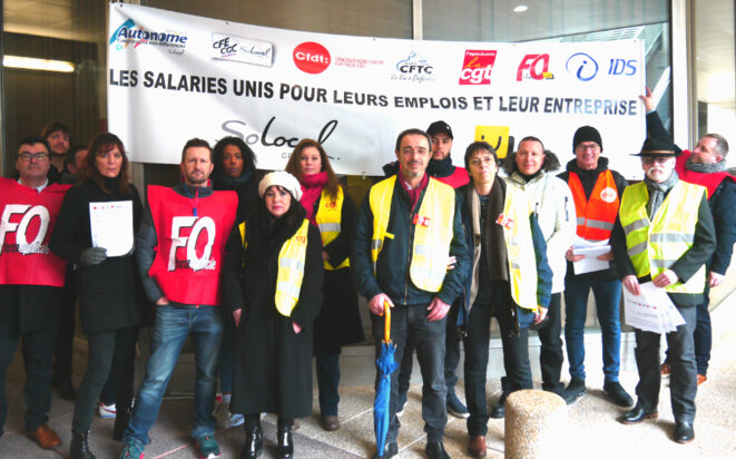 Members of the inter-union group representing staff at SoLocal, owners of France's 'Yellow Pages', at La Défense in Paris, March 9th, 2018.